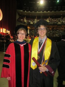 I got to give my research student his diploma at graduation.  Here we are, backstage, immediately afterwards!